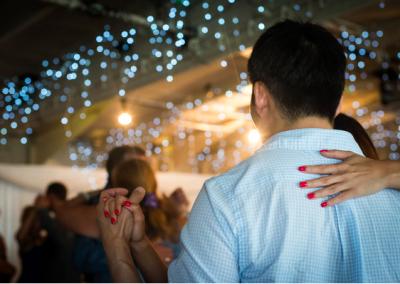 dancing tango under twinkling blue lights