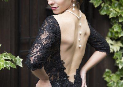 female tango teacher looking over her shoulder