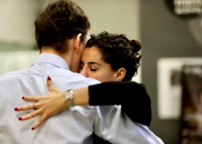 tango students in an intense embrace