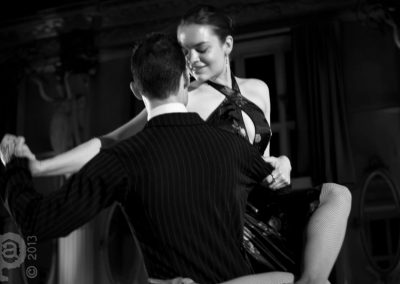 Tango dancer smiling as she is lifted