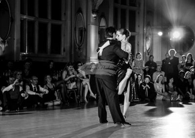 Tango dancers embracing in a performance