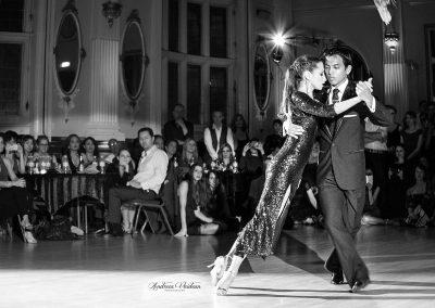 tango dancer leaning on her partner
