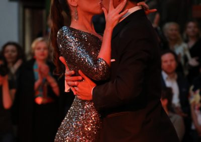 David and Kim share a kiss at the end of a show