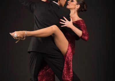 tango dancers posing in red