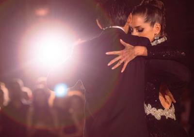 tango dancers under a spotlight
