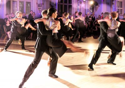 tango students mid-air in their show