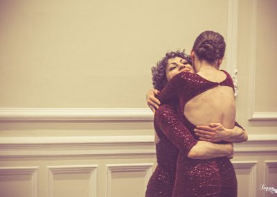 Tango friends hugging after their show