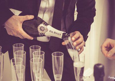 David pouring champagne