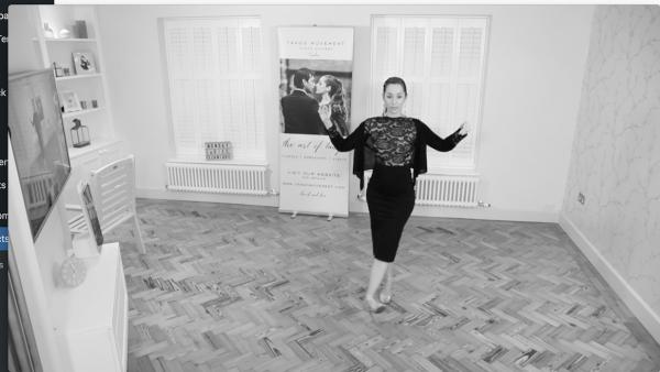Kim demonstrating followers' tango technique