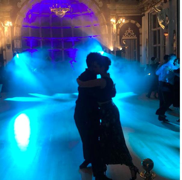 couple dancing tango on an empty dancefloor