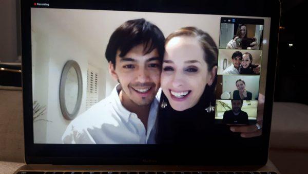 David and Kim smiling at the computer screen
