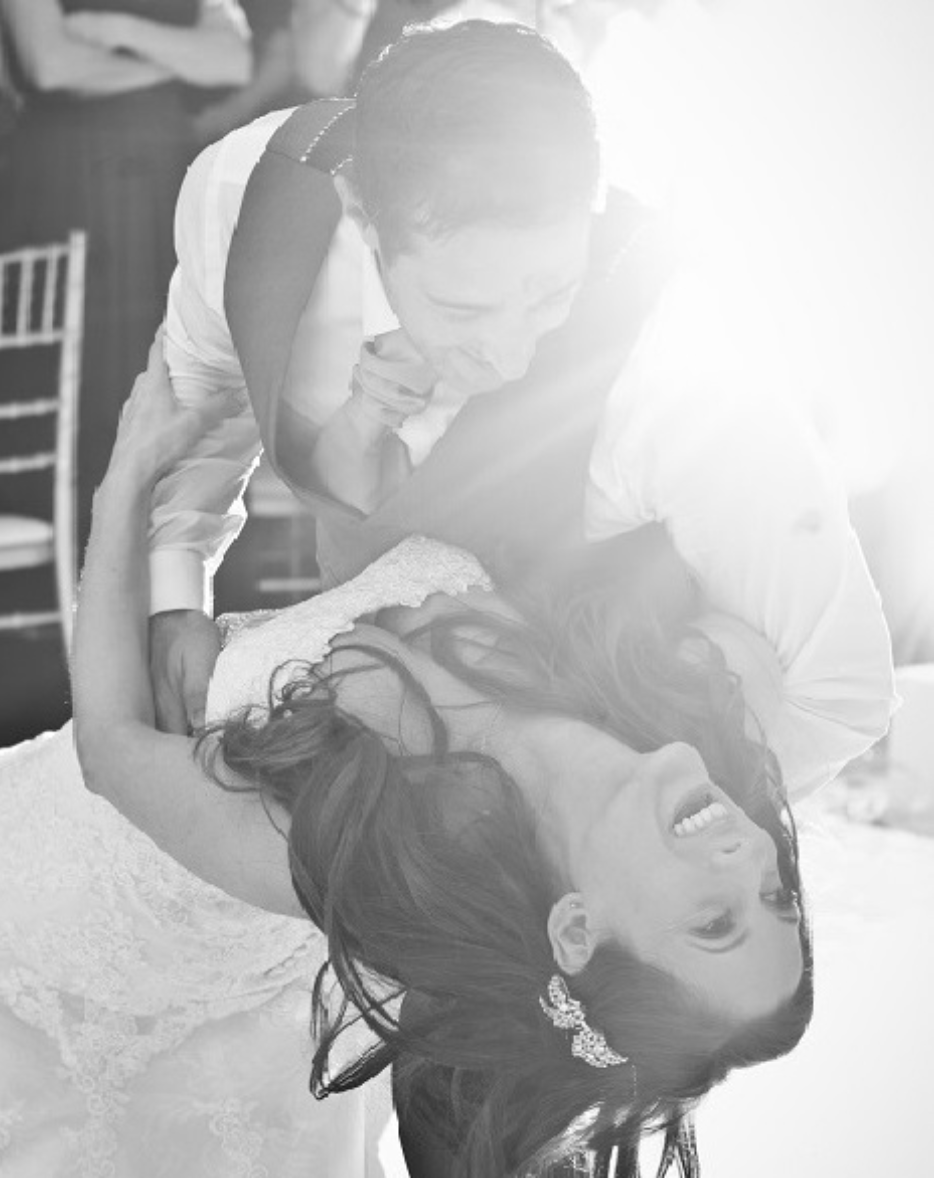 bride and groom laughing in a tango pose