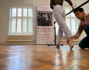 close-up on teacher's footwork in Zoom class