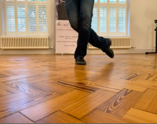 Close-up on teacher's dancing feet